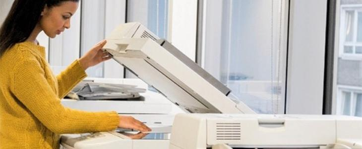 Lady using a photocopier