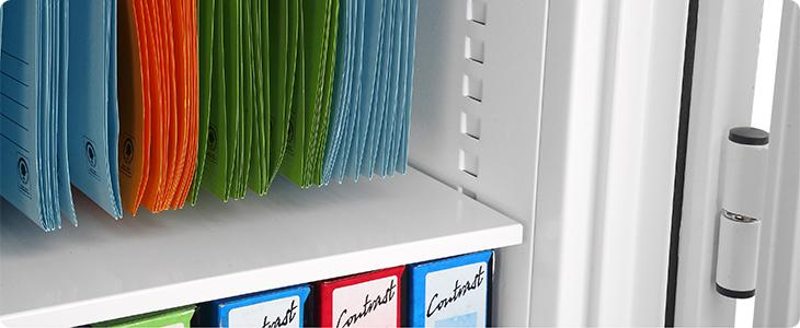 Hanging files within a metal cabinet