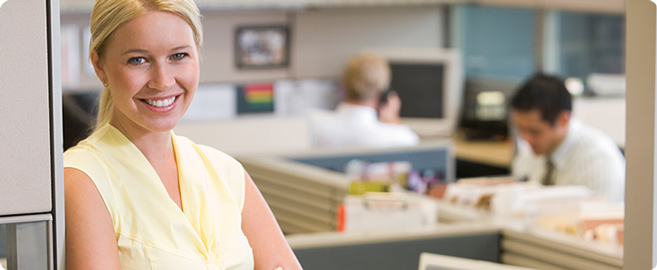 A photo of a smiling woman in an offices. Imagedirect - complete supply solution
