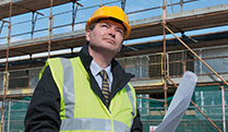 Man with hard hat on site