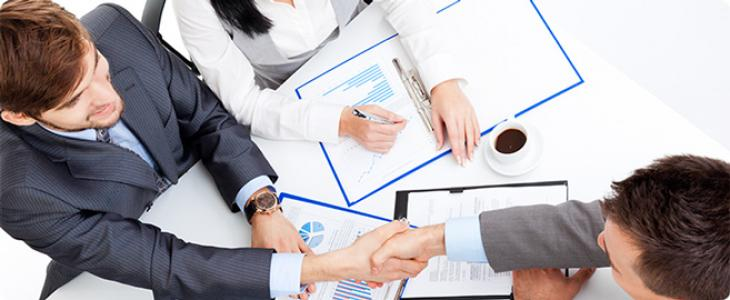 People meeting to review an account plan
